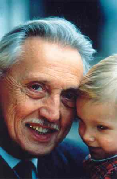 Photo of Professor Lejeune holding a child